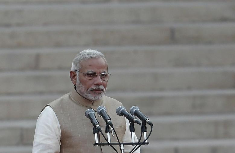 India's Prime Minister Narendra Modi takes his oath at the presidential palace in New Delhi May 26, 2014. REUTERS/Adnan Abidi