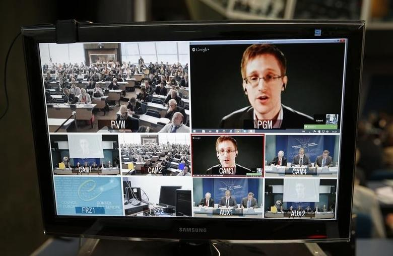 Accused government whistleblower Edward Snowden is seen on a screen as he speaks via video conference with members of the Committee on legal Affairs and Human Rights of the Parliamentary Assembly of the Council of Europe during a hearing on ''mass surveillance'' at the Council of Europe in Strasbourg, April 8, 2014.  REUTERS/Vincent Kessler