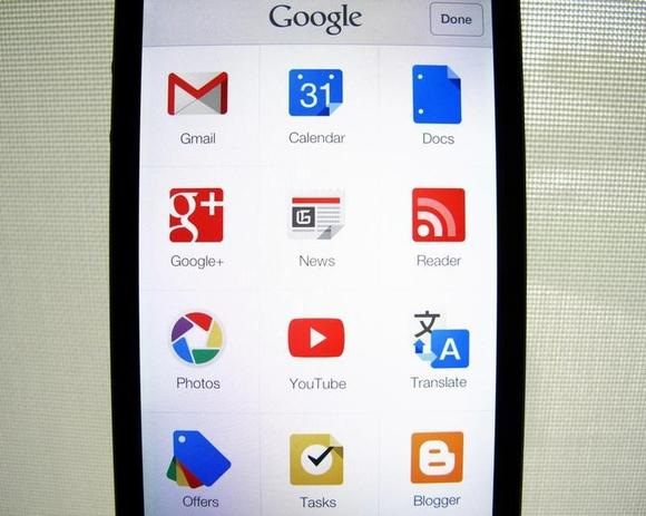 Google apps are shown on an Apple iphone 5 in this photo illustration in Encinitas, California, April 16, 2013. REUTERS/Mike Blake/Files