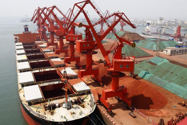 Metals are seen transported at Qingdao port, Shandong province, May 1, 2010.  REUTERS/Stringer