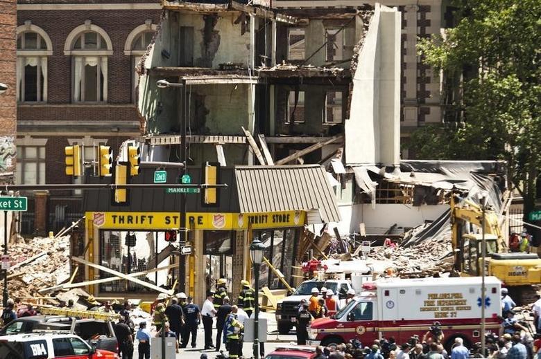 Rescue workers search through rubble following a building collapse in Philadelphia June 5, 2013. REUTERS/Eduardo Munoz