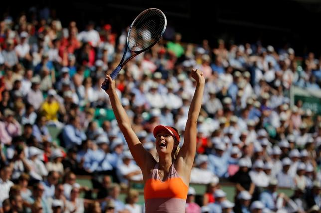 Maria Sharapova of Russia reacts after winning her women's semi-final match against Eugenie Bouchard of Canada at the French Open tennis tournament at the Roland Garros stadium in Paris June 5, 2014.  REUTERS/Stephane Mahe