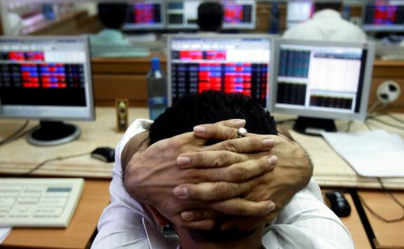 A broker reacts while trading at a stock brokerage firm in Mumbai October 8, 2008. REUTERS/Arko Datta/Files