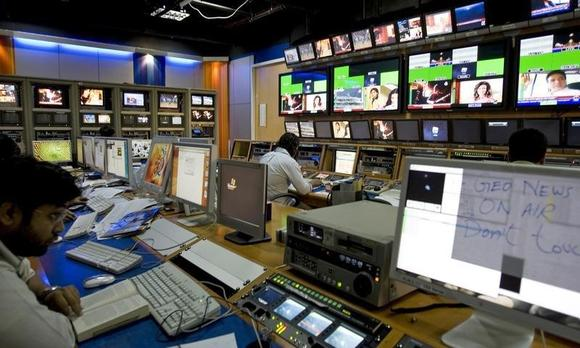 TV producers work at a control room of Geo News, a Dubai-based Pakistani television network, in Dubai November 18, 2007. REUTERS/Steve Crisp/Files