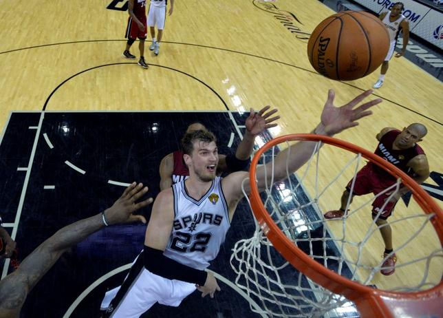 Jun 5, 2014; San Antonio, TX, USA; San Antonio Spurs center Tiago Splitter (22) shoots the ball during the third quarter against the Miami Heat in game one of the 2014 NBA Finals at AT&T Center. Mandatory Credit: Soobum Im-USA TODAY Sports