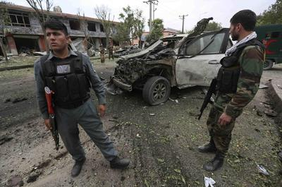 Afghan election front-runner escapes assassination...