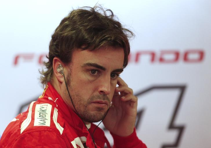 Ferrari driver Fernando Alonso of Spain prepares for the first free practice of the Canadian F1 Grand Prix at the Circuit Gilles Villeneuve in Montreal June 6, 2014.   REUTERS/Mathieu Belanger