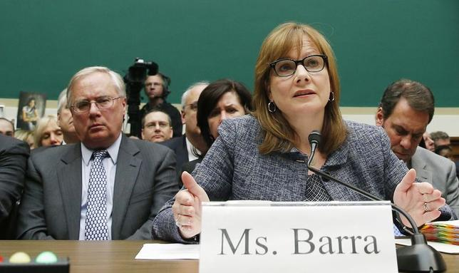 Michael Millikin (L), GM's general counsel since 2009 and a key counselor to Chief Executive Mary Barra (R) looks on as Barra testifies before the House Energy and Commerce Committee hearing on Capitol Hill in Washington in this April 1, 2014 file photo. REUTERS/Kevin Lamarque/Files