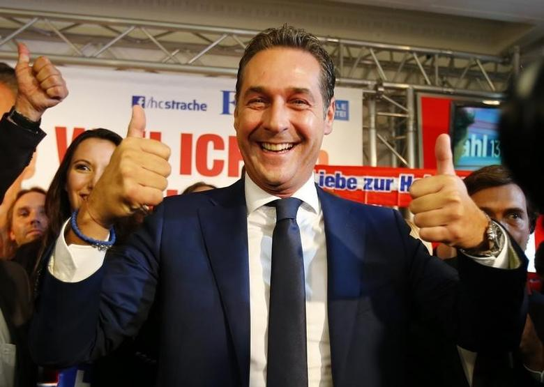 Head of the Freedom Party (FPOe) Heinz-Christian Strache react after first projections in the Austrian general election in Vienna September 29, 2013.  REUTERS/Dominic Ebenbichler