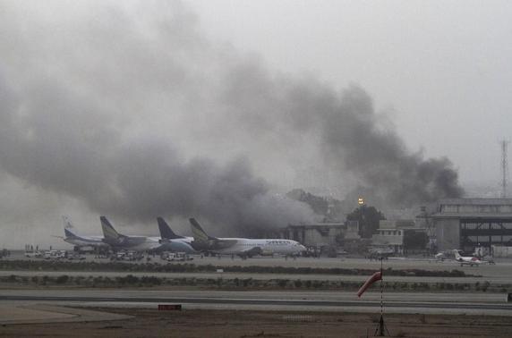 Smoke billows from Jinnah International Airport in Karachi June 9, 2014. REUTERS-Athar Hussain