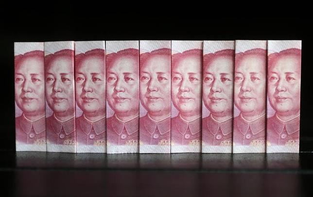 Chinese 100 yuan banknotes are seen in this picture illustration taken in Beijing July 11, 2013. REUTERS/Jason Lee/Files