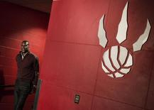 General Manager Masai Ujiri of the NBA basketball team Toronto Raptors walks out of the dressing room during the team's season-end media availability in Toronto, May 5, 2014.   REUTERS/Mark Blinch