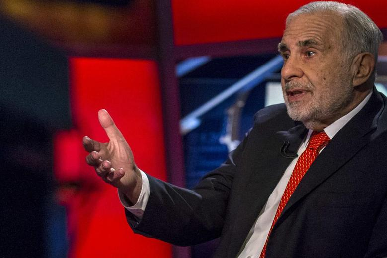 Billionaire activist investor Carl Icahn gives an interview on FOX Business Network's Neil Cavuto show in New York in this February 11, 2014 file photo.  REUTERS/Brendan McDermid