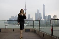 "Actress Angelina Jolie poses during a photocall as she takes part in a promotional tour for the film ""Maleficent"" in Shanghai June 3, 2014. REUTERS/Aly Song"