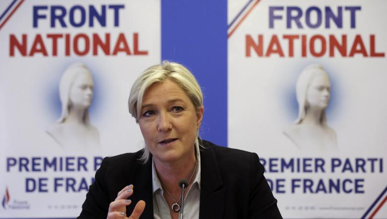Marine Le Pen, France's National Front political party head, attends a news conference at the party's headquarters in Nanterre, near Paris, May 27, 2014. REUTERS/Philippe Wojazer