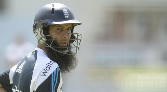 England's Moeen Ali looks on during a training session before Thursday's first cricket test match against Sri Lanka at Lord's cricket ground in London June 10, 2014. REUTERS/Philip Brown