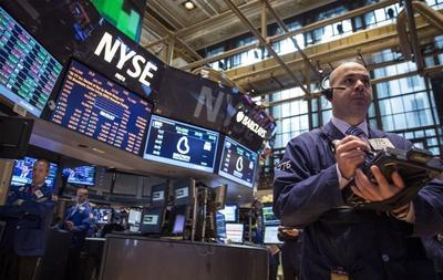 Wall St. edges up, lifted by mergers, acquisitions