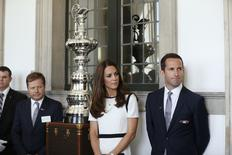 Britain's Catherine, Duchess of Cambridge stands with Ben Ainslie (R) during the launch of the British challenger team for the America's Cup, at the National Maritime Museum in London June 10, 2014. REUTERS/San Tan/pool