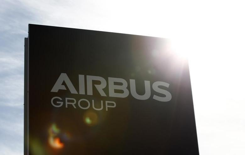The logo of Airbus Group, Europe's largest aerospace group, is pictured in front of the company headquarters building in Ottobrunn, near Munich February 26, 2014. REUTERS/Michaela Rehle/Files
