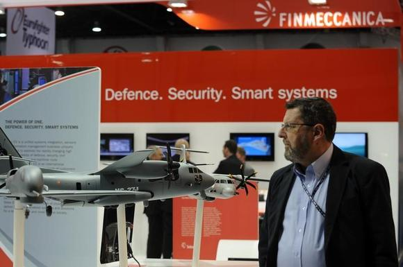 A visitor walks past a stand for Italian defence group Finmeccanica during the International Defence Exhibition and Conference (IDEX) at the Abu Dhabi National Exhibition Centre February 19, 2013. REUTERS/Ben Job/Files