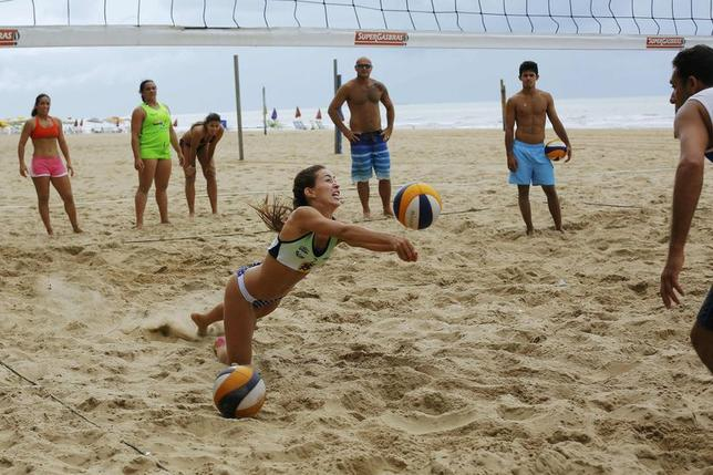 Volleyball players train on the beach in Recife June 11, 2014. REUTERS/Brian Snyder