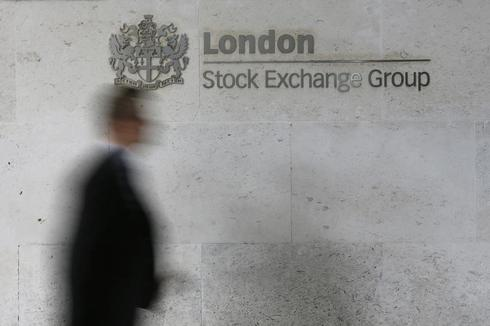 ITV, Unilever gains help FTSE steady within tight range