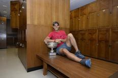 Rafael Nadal of Spain poses with his trophy in the dressing room after winning the men's singles final match during the French Open tennis tournament at the Roland Garros stadium in Paris June 8, 2014.  REUTERS/Christophe Saidi/FFT/Pool