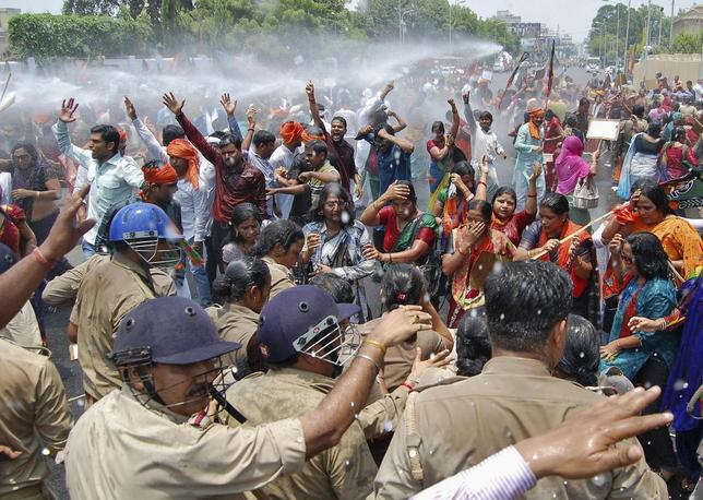 Supporters of Bharatiya Janata Party (BJP) shout slogans as police use a water cannon to stop them from moving towards the office of Akhilesh Yadav, the chief minister of the northern Indian state of Uttar Pradesh, during a protest against recent rape and hanging of two girls, in Lucknow June 2, 2014. REUTERS/Pawan Kumar