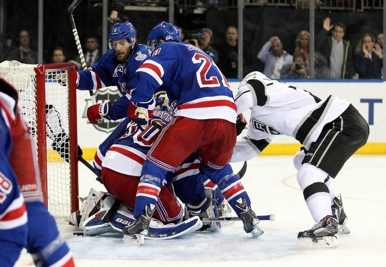 Jun 11, 2014; New York, NY, USA; (EDITORS NOTE: caption correction) The puck stops on the goal line behind New York Rangers goalie Henrik Lundqvist (30) , center Derek Stepan (21) and defenseman Dan Girardi (5) during the third period in game four of the 2014 Stanley Cup Final against the Los Angeles Kings at Madison Square Garden.  Jerry Lai-USA TODAY Sports