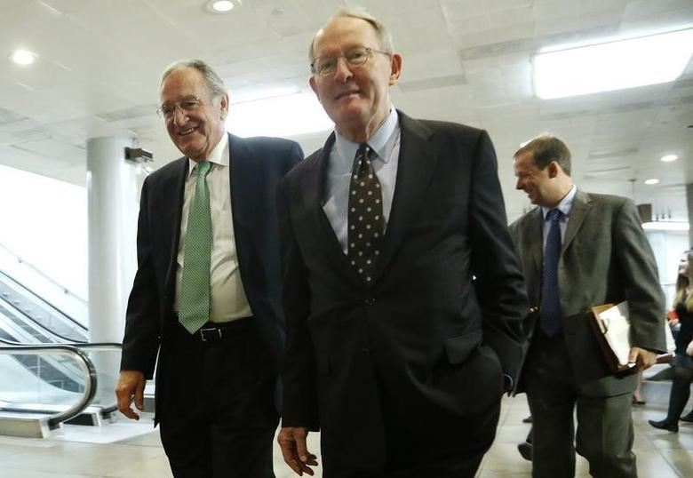 U.S. Senator Tom Harkin (D-IA) (L) and Senator Lamar Alexander (R-TN) (C) walk to a closed-door briefing on talks with Iran by Secretary of State John Kerry and Treasury Secretary Jack Lew at the U.S. Capitol in Washington December 11, 2013. REUTERS/Jonathan Ernst