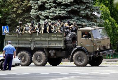 Ukrainian forces reclaim port city from rebels