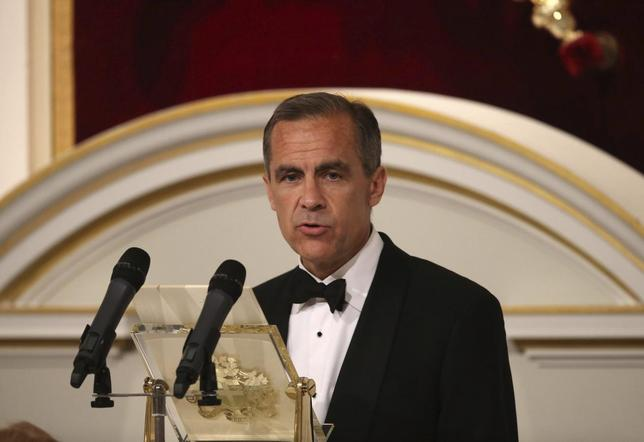 Mark Carney, Governor of the Bank of England, speaks at the 'Lord Mayor's Dinner to the Bankers and Merchants of the City of London' at the Mansion House in London June 12, 2014. REUTERS/Peter Macdiarmid/Pool