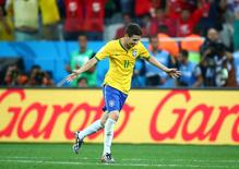 Brazil midfielder Oscar celebrates after scoring a goal in the second half against Croatia in the opening game of the 2014 World Cup at Arena Corinthians. Brazil defeated Croatia 3-1. Mark J. Rebilas-USA TODAY Sports