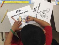 A first grader at Lambertville Public School creates two Father's Day cards for his two dads in Lambertville, New Jersey in this June 12, 2014. REUTERS/Rebecca Doser/Handout via Reuters