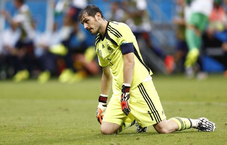 Spain's goalkeeper  Iker Casillas reacts after a goal by Netherlands during their  2014 World Cup Group B soccer match at the Fonte Nova arena in Salvador June 13,2014. REUTERS/Marcos Brindicci