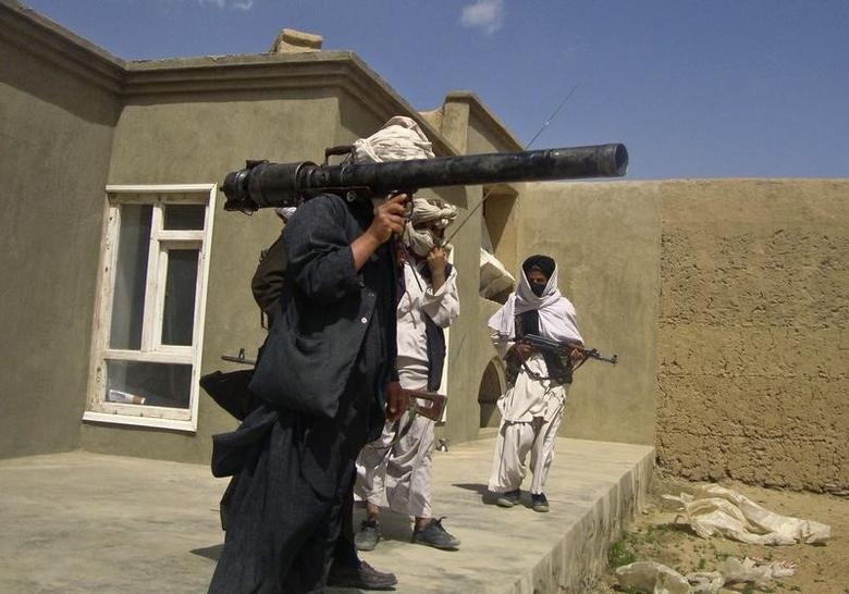 Taliban fighters pose with weapons at an undisclosed location in southern Afghanistan in this May 5, 2011 picture.  REUTERS/Stringer/Files