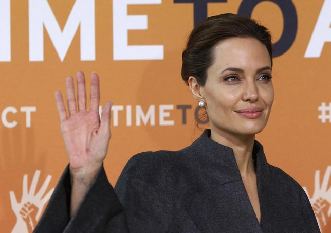 Actress and campaigner Angelina Jolie arrives at a summit to end sexual violence in conflict, at the Excel centre in London June 13, 2014. REUTERS/Luke MacGregor