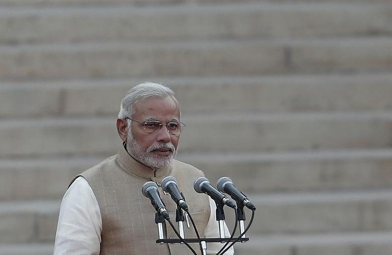Prime Minister Narendra Modi takes his oath at the presidential palace in New Delhi May 26, 2014. REUTERS/Adnan Abidi