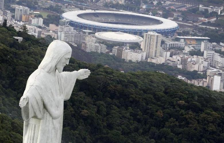 An aerial view of the famous Christ the Redeemer atop of Corcovado mountain in Rio de Janeiro, January 12, 2011. REUTERS/Bruno Domingos