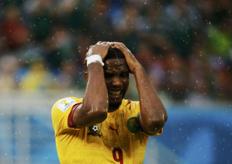 Cameroon's Samuel Eto'o reacts after missing a goal scoring opportunity against Mexico during their 2014 World Cup Group A soccer match at the Dunas arena in Natal June 13, 2014. REUTERS/Jorge Silva