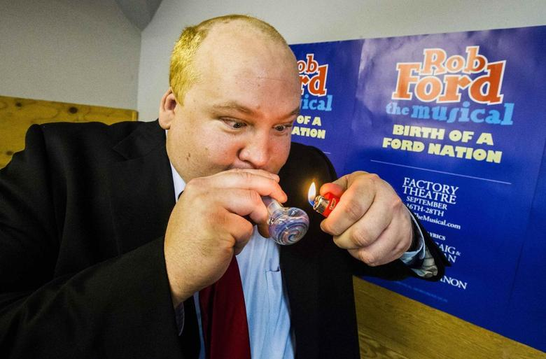 Geoff Stone poses for a picture as he pretends to smoke from a pipe following his audition for ''Rob Ford The Musical: The Birth of a Ford Nation'' in Toronto, June 16, 2014. REUTERS/Mark Blinch