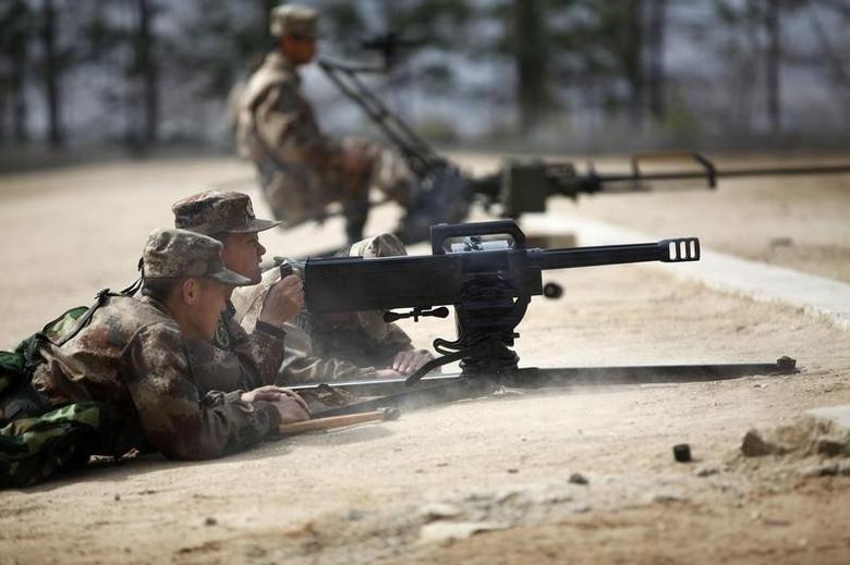 People's Liberation Army (PLA) soldiers fire weapons during training in Heihe, Heilongjiang province, April 14, 2014. Picture taken April 14, 2014. REUTERS/China Daily