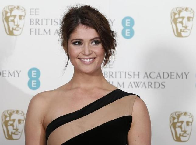 Gemma Arterton poses for photographers at the British Academy of Film and Arts (BAFTA) awards ceremony at the Royal Opera House in London February 10, 2013. REUTERS/Suzanne Plunkett