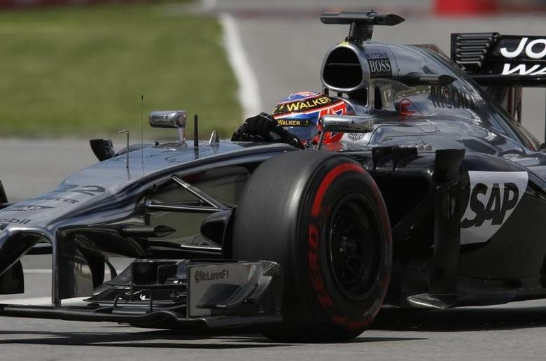 McLaren Formula One driver Jenson Button of Britain takes a curve during the qualifying session of the Canadian F1 Grand Prix at the Circuit Gilles Villeneuve in Montreal June 7, 2014. REUTERS/Chris Wattie