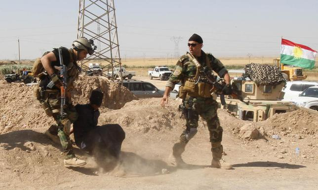 Personnel from the Kurdish security forces detain a man suspected of being a militant belonging to the al Qaeda-linked Islamic State in Iraq and the Levant (ISIL) in the outskirts of Kirkuk June 16, 2014. REUTERS/Ako Rasheed