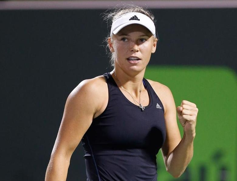 Caroline Wozniacki reacts against Li Na (not pictured) on day ten of the Sony Open at Crandon Tennis Center. Mandatory Credit: Geoff Burke-USA TODAY Sports