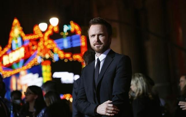 Cast member Aaron Paul poses at the premiere of the film ''Need for Speed'' at the TCL Chinese theatre in Hollywood, California March 6, 2014. REUTERS/Mario Anzuoni