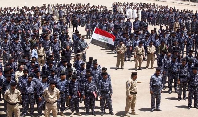 Volunteers, who have joined the Iraqi security forces to fight against the predominantly Sunni militants from the radical Islamic State of Iraq and the Levant (ISIL), wearing the police force uniforms gather in the holy city of Najaf, June 18, 2014. REUTERS/Alaa Al-Marjani