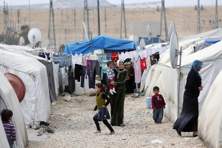 Syrian refugee women stand outside their tents at a refugee camp in Nizip in Gaziantep province, near the Turkish-Syrian border March 17, 2014. REUTERS/Murad Sezer