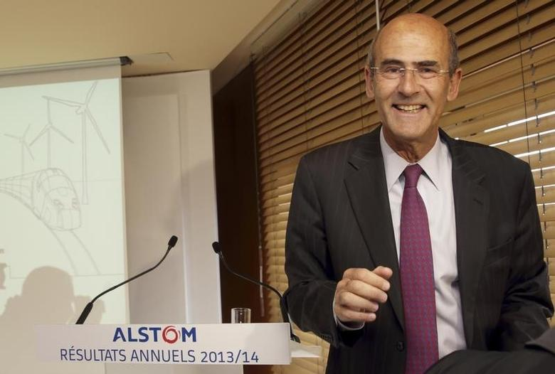 Alstom Chairman and Chief Executive Patrick Kron leaves the company's annual results presentation at the company headquarters in Levallois-Perret, near Paris, May 7, 2014. Alstom, the ailing French industrial engineering group facing a politically charged takeover battle for its power business, scrapped its dividend on Wednesday as it said it burned cash and saw orders fall 10 percent in its full year.  REUTERS/Philippe Wojazer (FRANCE - Tags: BUSINESS ENERGY TRANSPORT)